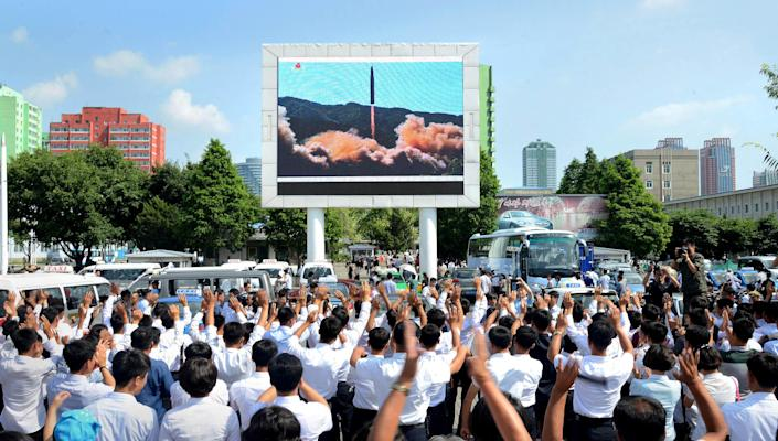 <p>People watch a huge screen showing the test launch of intercontinental ballistic missile Hwasong-14 in this undated photo released by North Korea's Korean Central News Agency (KCNA), July 5, 2017. (Photo: KCNA via Reuters) </p>
