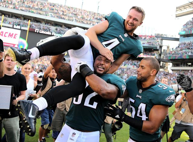 <p>Jake Elliott #4 of the Philadelphia Eagles is picked up by teammates Najee Goode #52 and Kamu Grugier-Hill #54 after Elliott kicked the game winning field goal with 1 second left in the game against the New York Giants on September 24, 2017 at Lincoln Financial Field in Philadelphia, Pennsylvania.Elliott kicked the 61 yard field goal to defeat the New York Giants 27-24. (Photo by Elsa/Getty Images) </p>