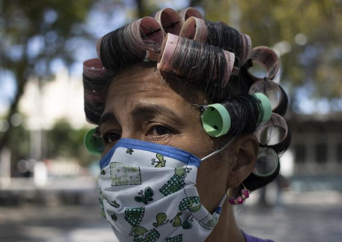 A woman wears a home made mask amid the spread of the new coronavirus as she walks outside in Caracas, Venezuela, Tuesday, March 17, 2020.(AP Photo/Ariana Cubillos)