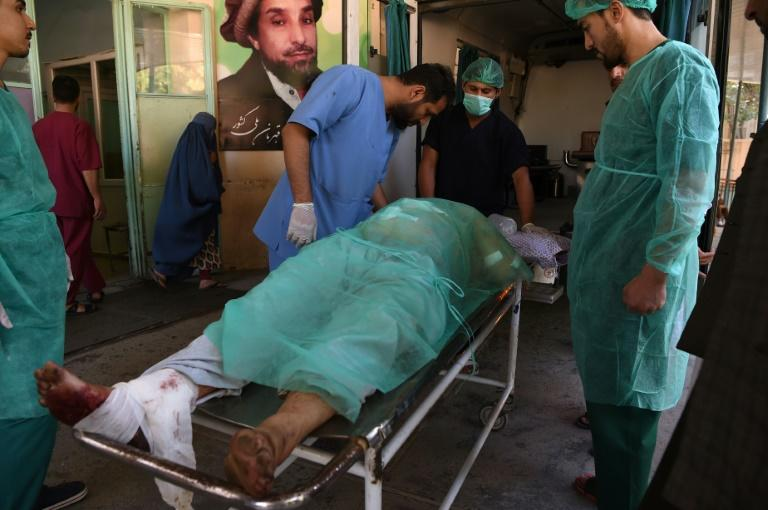 A wounded Afghan man receives treatment at a hospital following a blast outside a campaign rally for President Ashraf Ghani (AFP Photo/WAKIL KOHSAR)