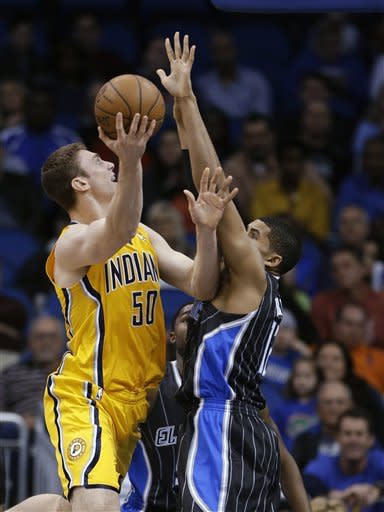 Indiana Pacers' Tyler Hansbrough (50) takes a shot over Orlando Magic's Tobias Harris during the first half of an NBA basketball game, Friday, March 8, 2013, in Orlando, Fla. (AP Photo/John Raoux)