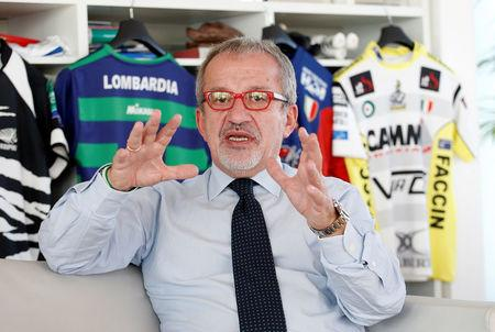 President of Lombardy Roberto Maroni gestures during an interview with Reuters in his office in Milan, Italy, October 12, 2017. REUTERS/Alessandro Garofalo