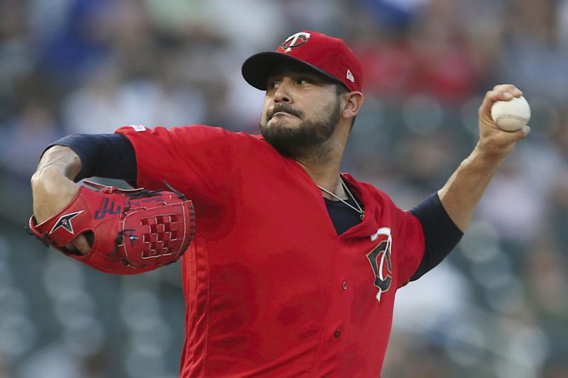 Minnesota Twins pitcher Martin Perez throws against the Chicago White Sox in the first inning of a baseball game Tuesday, Sept. 17, 2019, in Minneapolis. (AP Photo/Jim Mone)