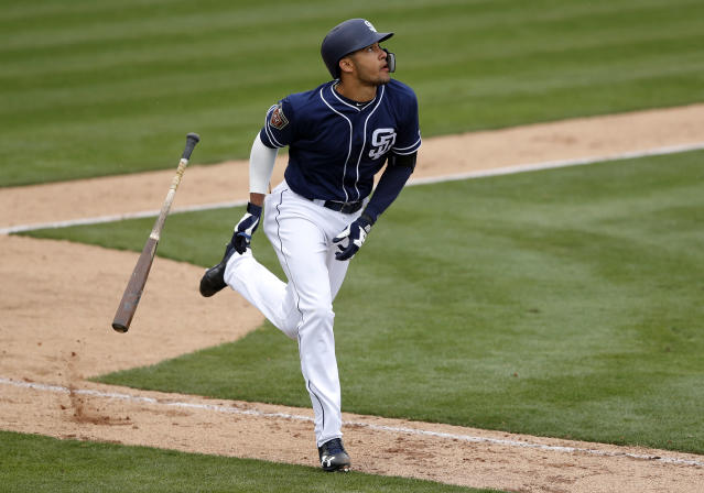 FILE - In this Friday, Feb. 23, 2018, file photo, San Diego Padres' Fernando Tatis runs up the first baseline after hitting a home run in the eighth inning of a spring training baseball game against the Seattle Mariners in Peoria, Ariz. Tatis' eagerly awaited major league debut most likely will come this year, if not on opening day then after he gets some time in Triple-A. (AP Photo/Charlie Neibergall, File)