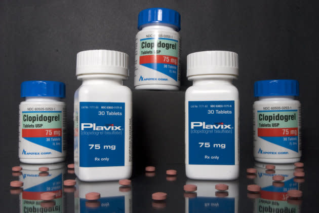 Bottles of Plavix heart pills manufactured by Sanofi-Aventis and Bristol-Myers Squibb, are pictured with the Apotex generic, Clopidogrel.