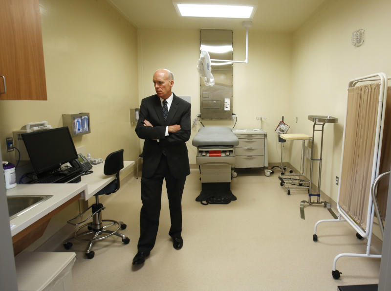 David Culberson, chief executive officer of San Joaquin General Hospital, looks over one of the patient care rooms while touring the new California Correctional Health Care Facility in Stockton, Calif., Tuesday, June 25, 2013. Dignitaries and the media toured the $839 million facility after dedication ceremonies. The facility, which is expected to begin receiving inmates in July, will treat up to 1, 720 patients in need of long-term care, freeing up staff and treatment space at the state's 33 adult prisons. The San Joaquin General Hospital will provide more intensive care not available at CHCF. (AP Photo/Rich Pedroncelli)