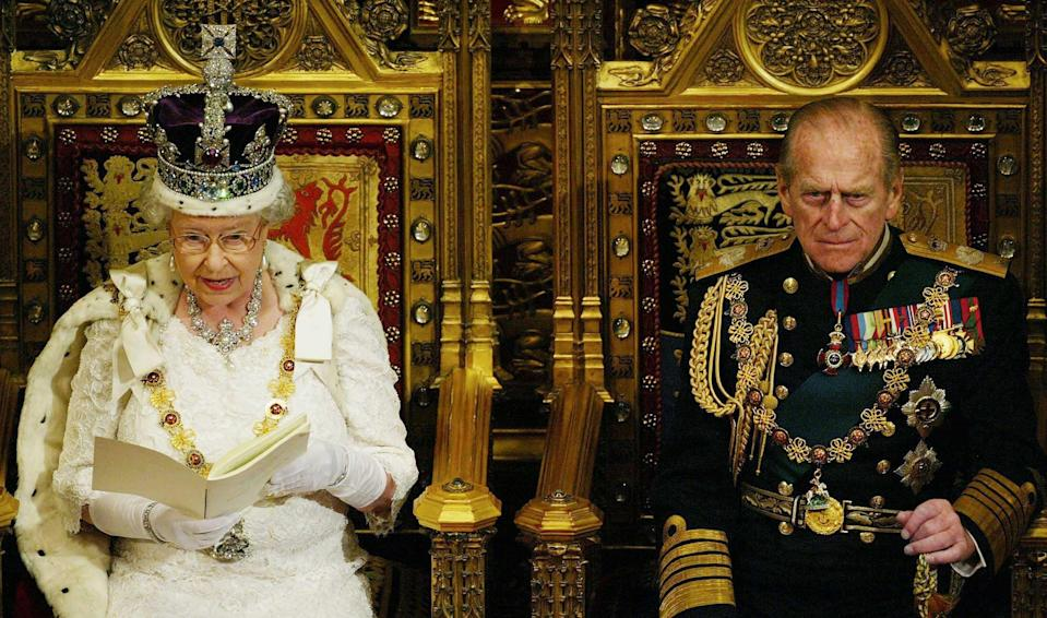 File photo dated 26/11/03 of Queen Elizabeth II with the Duke of Edinburgh as she made the Queen's Speech, to members of the House of Lord and the House of Commons during the State Opening of Parliament in London. Philip succeeded at being a royal consort because he shared the Queen's dedication to duty without looking as though he was trying to be King, one royal writer suggested. Issue date: Friday April 4, 2021.