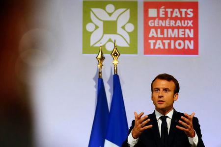 French President Emmanuel Macron delivers his speech during a meeting at Rungis international food market in Rungis