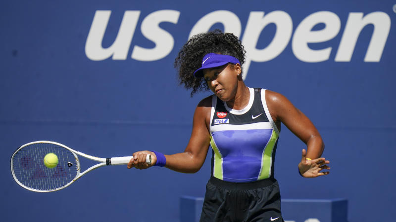 Naomi Osaka, of Japan, returns a shot to Marta Kostyuk, of the Ukraine, during the third round of the US Open tennis championships, Friday, Sept. 4, 2020, in New York. (AP Photo/Seth Wenig)