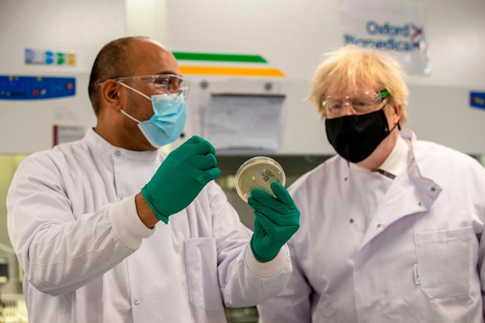 Boris Johnson speaks with Dipesh Sonar as he visits the quality control laboratory at Oxford BioMedica where batches of the Oxford/AstraZeneca Covid-19 vaccine are tested as part of the manufacturing process (Photo: HEATHCLIFF O'MALLEY via Getty Images)