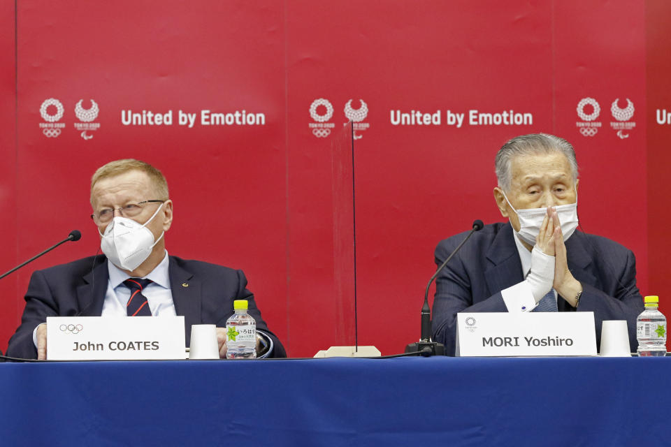Yoshiro Mori, president of the Tokyo 2020 organizing committee, right, sits with John Coates, chairman of the Coordination Commission for the Tokyo 2020 Olympics, during a press conference in Tokyo, Wednesday, Nov. 18, 2020. (Rodrigo Reyes Marin/Pool Photo via AP)