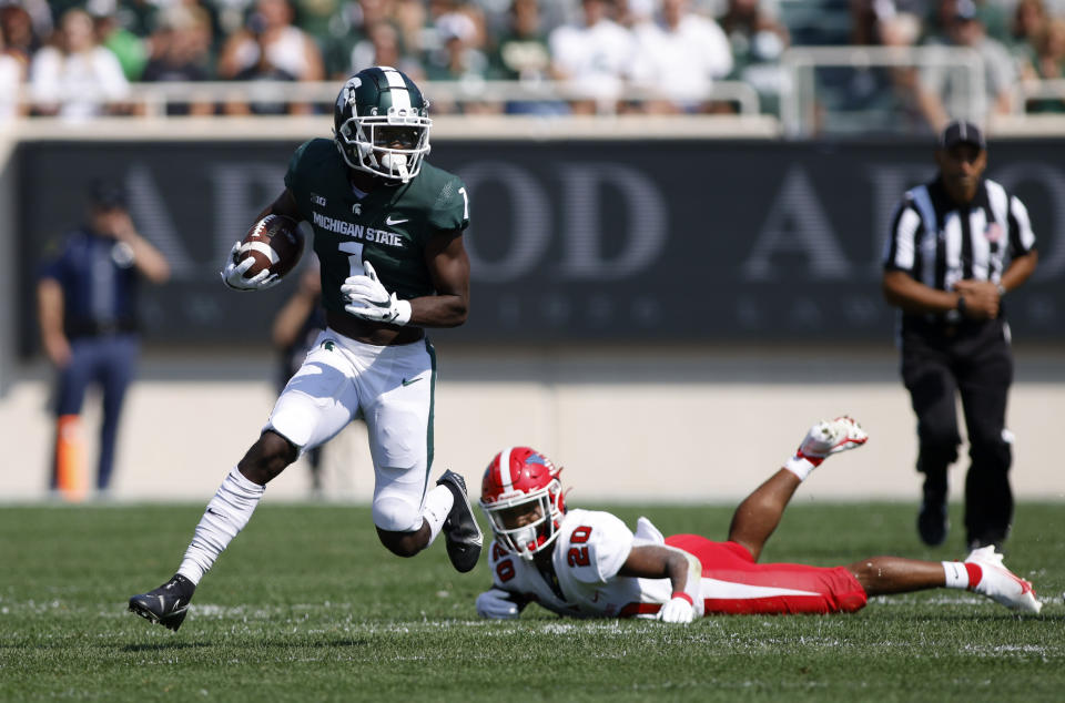 Michigan State wide receiver Jayden Reed, left, faces Natavious Payne (20) of Youngstown State in the first quarter of an NCAA college football game on Saturday, September 11, 2021, in East Lansing , Michigan.  Michigan State won 42-14.  (AP Photo / Al Goldis)