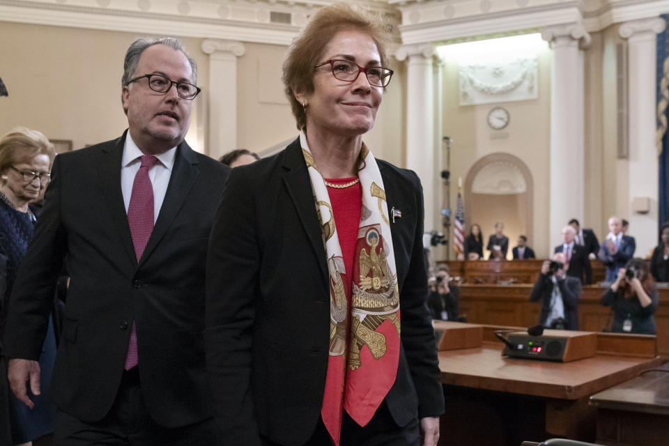 FILE - In this Nov. 15, 2019, file photo, former U.S. Ambassador to Ukraine Marie Yovanovitch smiles as the audience applauds at the end her testimony before the House Intelligence Committee on Capitol Hill in Washington. The U.S. Attorney's Office in Manhattan has returned to the question of whether to bring a criminal case against the former New York City mayor Rudy Giuliani, focusing at least in part on whether he broke U.S. lobbying laws by failing to register as a foreign agent, according to people familiar with the case. (AP Photo/J. Scott Applewhite, File)