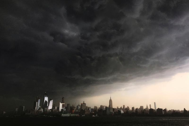 Storm clouds gather over New York city seen from the Hudson River: AP