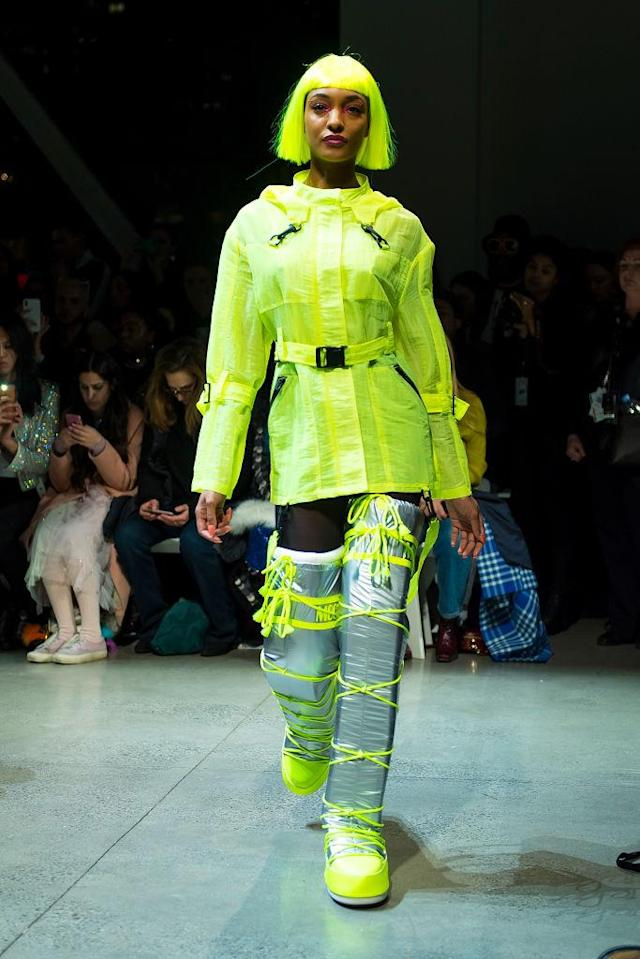 <p>Model wears a lime green jacket, matching hair and metallic silver and green moom boots at Jeremy Scott's Fall 2018 show. (Photo: Getty) </p>