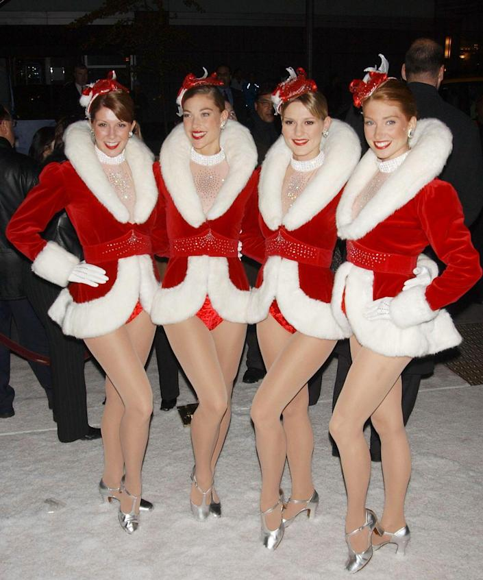 """<p>If you and your girls are always in sync, then you should you transform yourself into the Radio City Rockettes. </p><p><a class=""""link rapid-noclick-resp"""" href=""""https://www.amazon.com/Womens-Santa-Costume-Claus-Christmas/dp/B07KNTQ12T?tag=syn-yahoo-20&ascsubtag=%5Bartid%7C10070.g.3083%5Bsrc%7Cyahoo-us"""" rel=""""nofollow noopener"""" target=""""_blank"""" data-ylk=""""slk:SHOP RED JACKETS"""">SHOP RED JACKETS</a></p>"""
