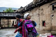The language spoken by the Qiang mostly endures in villages clinging to mountainsides only accessible by narrow roads with treacherous switchbacks