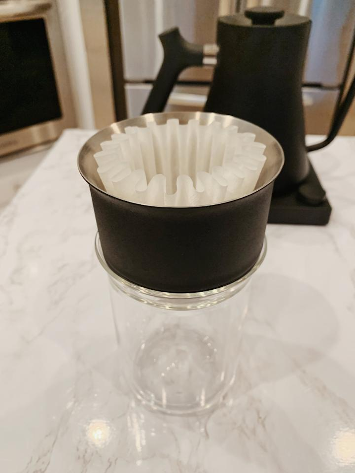 <p>Place the dripper on top of your glass, then set the filter right on top.</p>