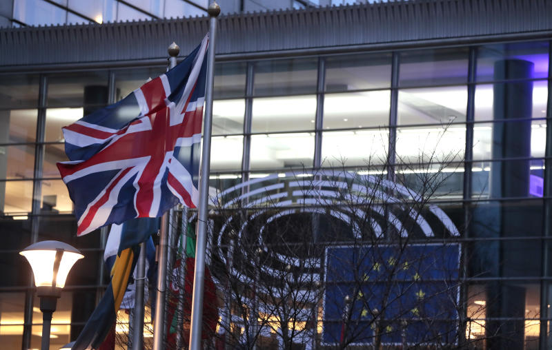 The Union flag flaps in the wind with flags of other EU countries outside the European Parliament in Brussels, Friday, Jan. 31, 2020. The U.K. is due to leave the EU on Friday the first nation in the bloc to do so. (AP Photo/Virginia Mayo)