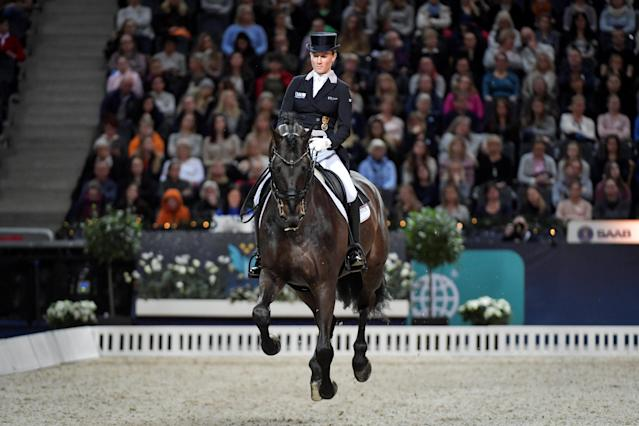 Equestrian - Sweden International Horse Show - FEI Grand Prix Freestyle to Music event - Friends Arena, Stockholm, Sweden - December 3, 2017 - Helen Langehanenberg of Germany rides her horse Damsey FRH. TT News Agency/Jessica Gow via REUTERS ATTENTION EDITORS - THIS IMAGE WAS PROVIDED BY A THIRD PARTY. SWEDEN OUT. NO COMMERCIAL OR EDITORIAL SALES IN SWEDEN