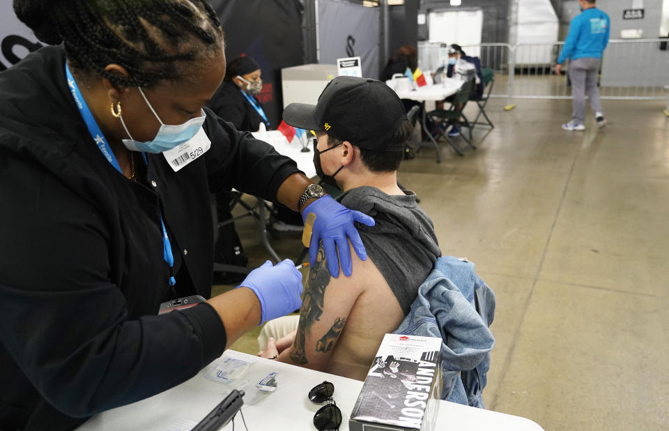 Christian Valcich is given the J&J COVID vaccine in coordination with the Cook County Health Dept. and the Chicago White Sox. (David Banks/Getty Images)