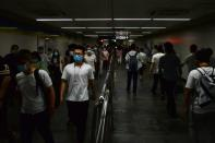 People wearing face masks walk inside a subway station, following the an outbreak of the novel coronavirus disease (COVID-19), in Beijing