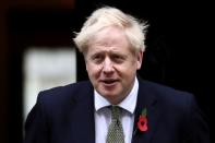 Britain's Prime Minister Boris Johnson meets fundraisers for the Royal British Legion outside Downing Street in London