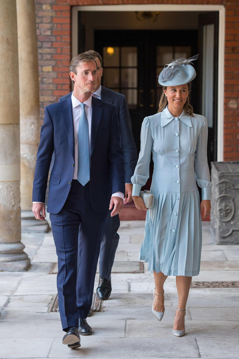 <p>For her nephew's royal christening on 9 July 2018, Pippa Middleton chose a powder blue dress by Alessandra Rich. She accessorised the look with a co-ordinating hat by Jane Taylor and Jimmy Choo shoes. <em>[Photo: PA]</em> </p>