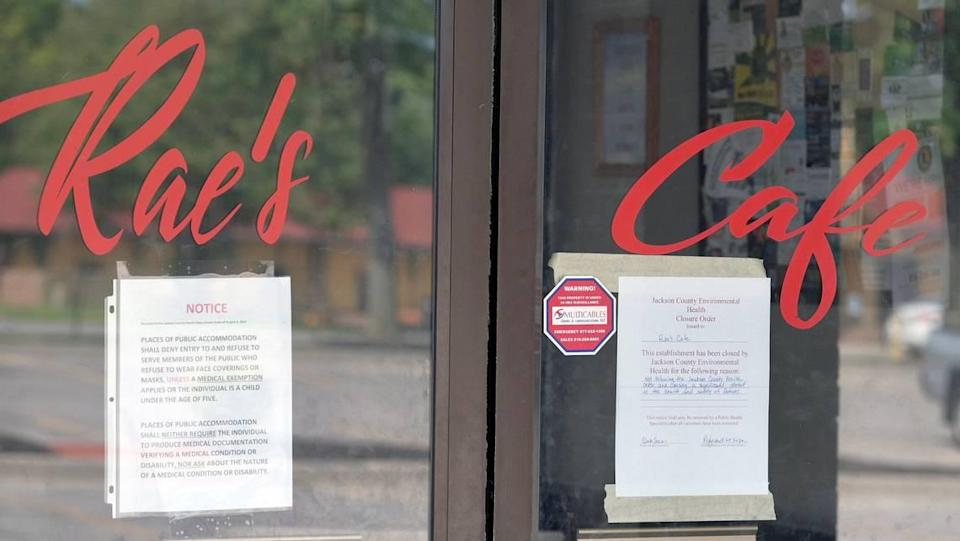 """Notices on the doors to Rae's Cafe in Blue Springs announce that the restaurant has been closed for """"not following the Jackson County Health order and causing a significant threat to the health and safety of patrons."""" The cafe's food establishment permit was revoked for repeated violations of the order requiring masks."""