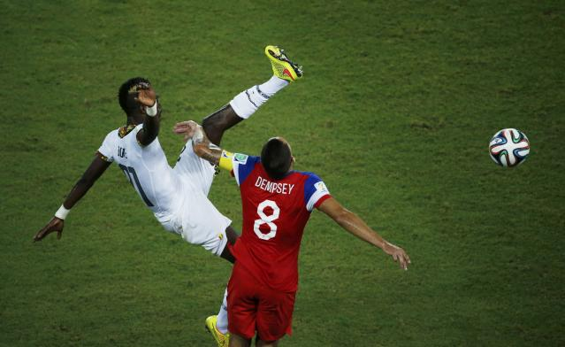 Ghana's John Boye (L) kicks high and knocks into the face of Clint Dempsey of the U.S. during their 2014 World Cup Group G soccer match at the Dunas arena in Natal June 16, 2014. REUTERS/Carlos Barria (BRAZIL - Tags: SOCCER SPORT WORLD CUP TPX IMAGES OF THE DAY)