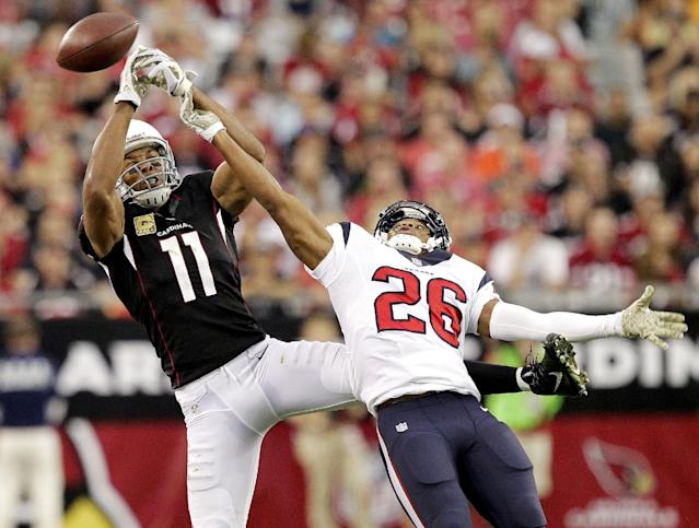 Arizona Cardinals wide receiver Larry Fitzgerald (11) can't catch a pass as Houston Texans defensive back Brandon Harris (26) defends during the first half of an NFL football game Sunday, Nov. 10, 2013, in Glendale, Ariz. (AP Photo/Rick Scuteri)