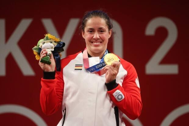 Canada's Maude Charron won a gold medal in weightlifting Tuesday in Tokyo. It is Canada's second weightlifting gold at the Olympics, following Christine Girard's performance at the London 2012 Games. (Chris Graythen/Getty Images - image credit)
