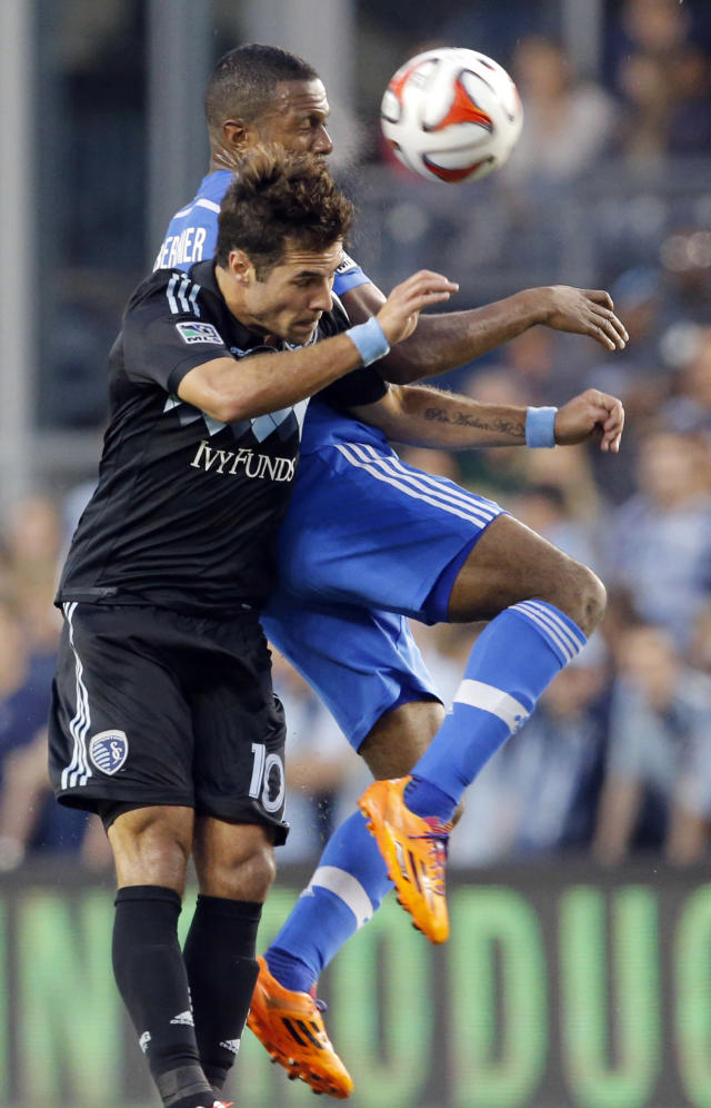 Sporting KC midfielder Benny Feilhaber (10) and Montreal Impact midfielder Patrice Bernier, back, head the ball during the first half of an MLS soccer match in Kansas City, Kan., Saturday, April 19, 2014. (AP Photo/Orlin Wagner)