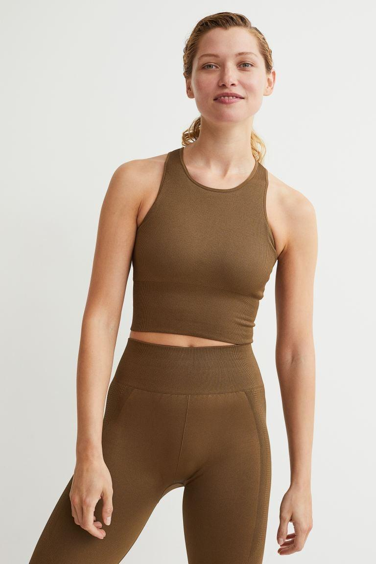 <p>If you want a comfortable, cropped layering piece, this <span>H&amp;M Seamless Sports Bralette</span> ($20) is a good pick. It'll look great underneath a shirt jacket.</p>