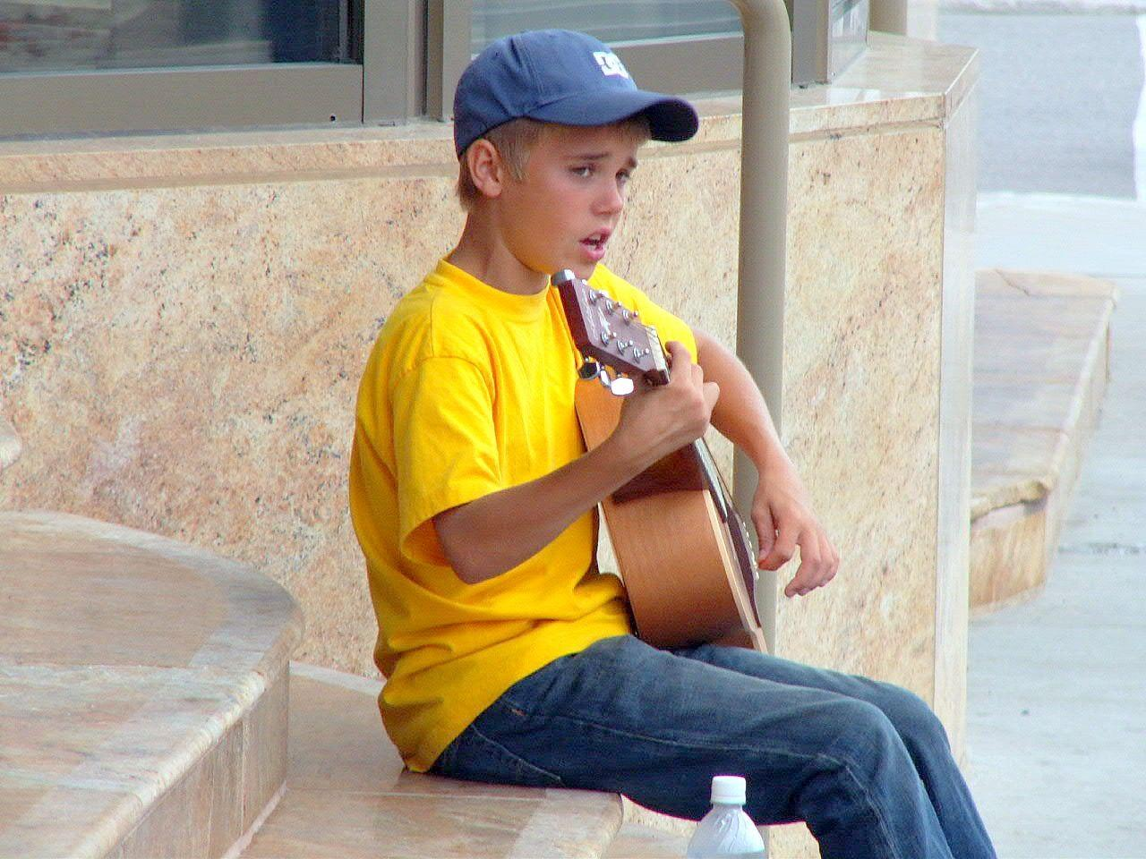 "<p>Born in Ontario, Canada on March 1, 1994, Justin Bieber got his <a href=""https://abcnews.go.com/GMA/Weekend/teen-pop-star-justin-bieber-discovered-youtube/story?id=9068403"" target=""_blank"">big break</a> in 2008 after a video he posted to YouTube caught the attention of manager Scooter Braun and superstar singer, Usher Raymond, who signed him to their record company.</p>"