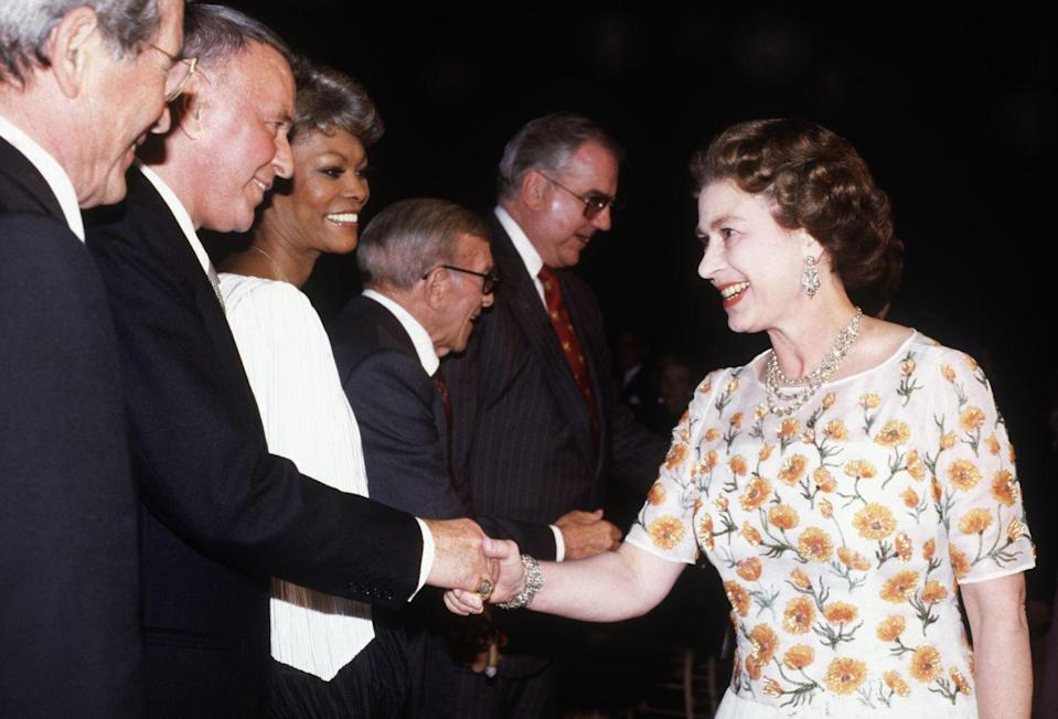 <p>What does Ol' Blue Eyes wear when he meets the Queen? Typical of the crooner, Frank Sinatra wore his best tailored suit for the event at the 20th Century Fox studios in 1983. </p>
