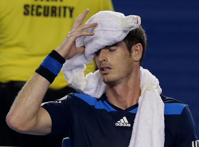 Andy Murray of Britain rests in his chair during his second round match against Vincent Millot of France at the Australian Open tennis championship in Melbourne, Australia, Thursday, Jan. 16, 2014.(AP Photo/Aaron Favila)