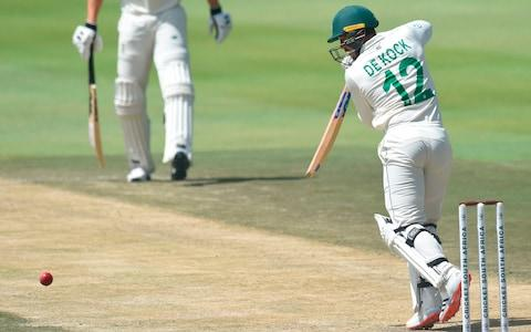 Quinton de Kock drives - Credit: AFP
