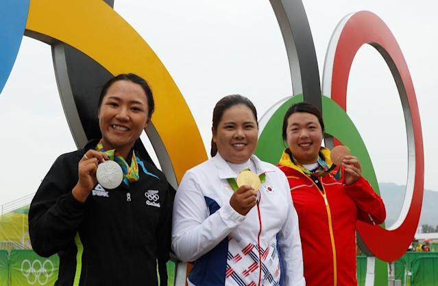 "<div class=""caption""> Silver medalist Lydia Ko of New Zealand, gold medalist Inbee Park of Korea and bronze medalist Shanshan Feng of China pose after Women's Golf competition at the 2016 Rio games. </div> <cite class=""credit"">Scott Halleran</cite>"