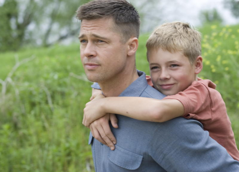 """In this publicity image released by Fox Searchlight films, Brad Pitt, left, and Laramie Eppler are shown in a scene from """"The Tree of Life."""" For the first time in the three years since Oscar organizers expanded the best-picture category to more than five films, there's not a single blockbuster in the running. """"The Tree of Life"""" took in a slim $13.3 million domestically. (AP Photo/Fox Searchlight, Merie Wallace)"""
