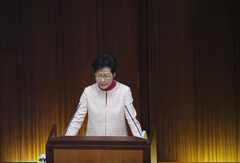 """Hong Kong Chief Executive Carrie Lam delivers her policy speech at the Legislative Council in Hong Kong Wednesday, Oct. 10, 2018. Lam has unveiled a major reclamation project called """"Lantau Tomorrow Vision,"""" under which about 1,700 hectares will be developed to provide homes for 1.1 million people, according to government radio. (AP Photo/Vincent Yu)"""