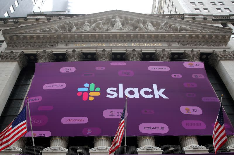 FILE PHOTO: The Slack Technologies Inc. logo is seen on a banner outside the New York Stock Exchange (NYSE) during the company's direct listing in New York
