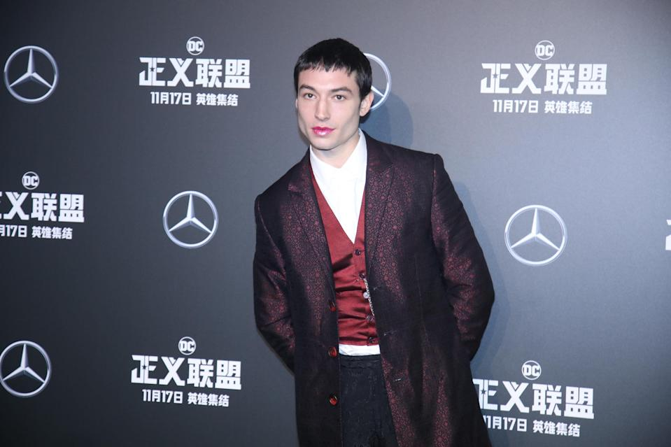 Ezra Miller rocked up to the 'Justice League' red carpet wearing Fenty Beauty lip gloss [Photo: Getty]