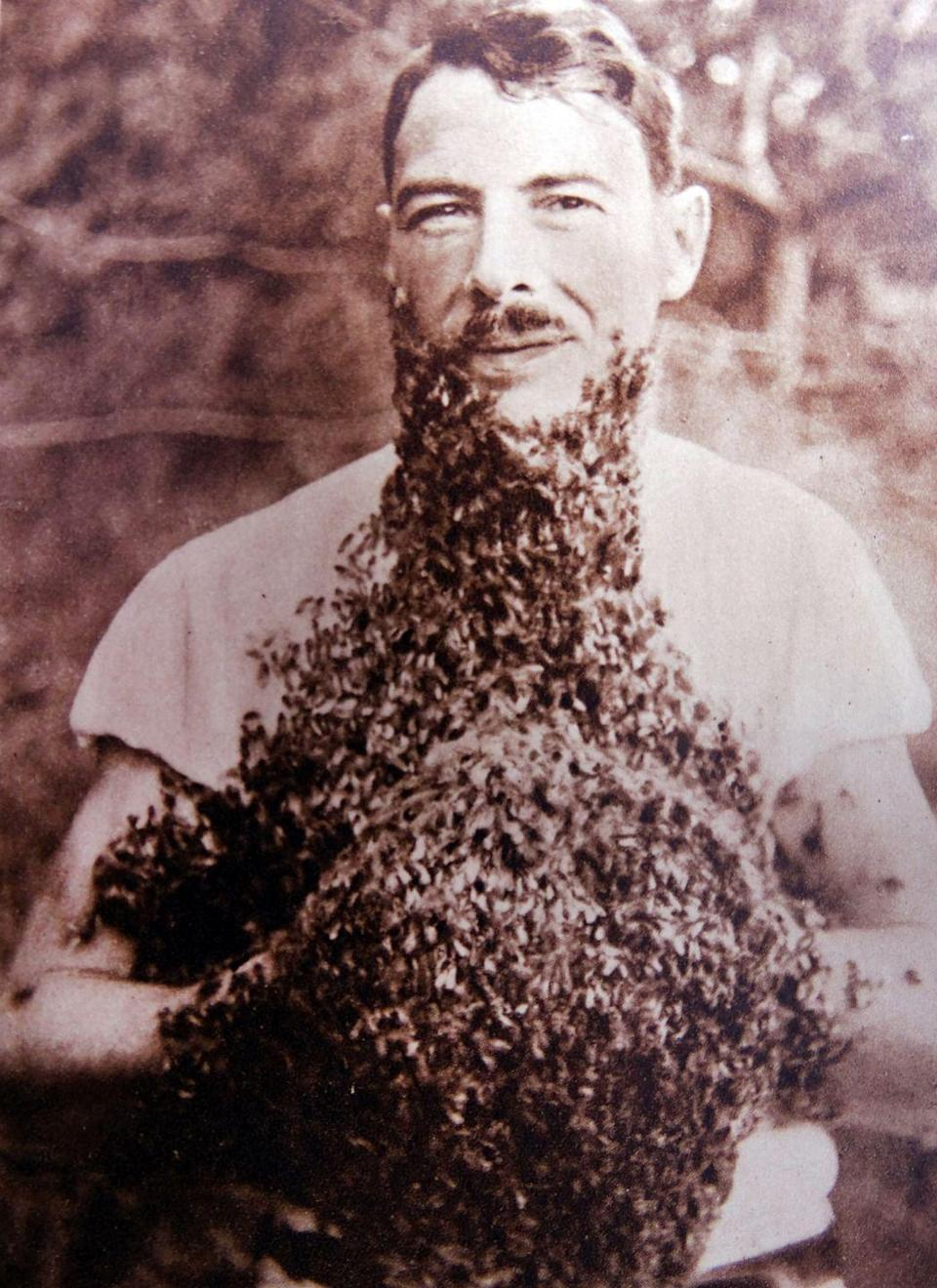 <p>We have no idea why this man would dare have so many bees around his face and in his hands, but we're certain he must have walked away with at least one or two stings. At least he was able to stand still long enough to snap this photo back in 1930, or we might not have believed it.</p>