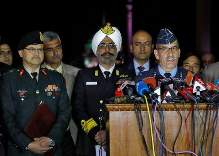 India's Air Vice-Marshal R.G.K Kapoor (R) flanked by Navy's Rear Admiral DS Gujral (C) and Army's Major General Surinder Singh Mahal speaks with the media in the lawns of India's Defence Ministry in New Delhi, India, February 28, 2019. REUTERS/Anushree Fadnavis