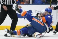 New York Islanders' Matt Martin (17) fights with Boston Bruins' Jarred Tinordi (84) during the first period of Game 4 during an NHL hockey second-round playoff series Saturday, June 5, 2021, in Uniondale, N.Y. (AP Photo/Frank Franklin II)