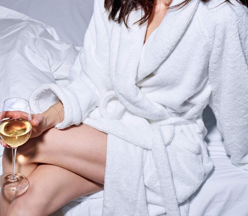 """<h3><h2>Snowe Classic Bathrobe</h2></h3><br>Wondering what type of activities you can partake in while wearing your new luxurious robe? Well, drinking wine is just the tip of that iceberg. Snowe Home's classic-style bathrobe is crafted from the plushest air-woven terry cotton to mimic a high-end hotel spa feel.<br><br>""""As I had read from previous reviewers, my new white robe is the fluffiest. I can't wait to shower and slip into it each night to relax and feel wrapped in luxury. Well done Snowe!"""" and """"Like a warm, encompassing hug and there is a moment of all is good,"""" one robed lounger raved. <br><br><strong>Snowe</strong> Classic Bathrobe, $, available at <a href=""""https://go.skimresources.com/?id=30283X879131&url=https%3A%2F%2Fsnowehome.com%2Fproducts%2Fclassic-terry-bathrobe"""" rel=""""nofollow noopener"""" target=""""_blank"""" data-ylk=""""slk:Snowe"""" class=""""link rapid-noclick-resp"""">Snowe</a>"""