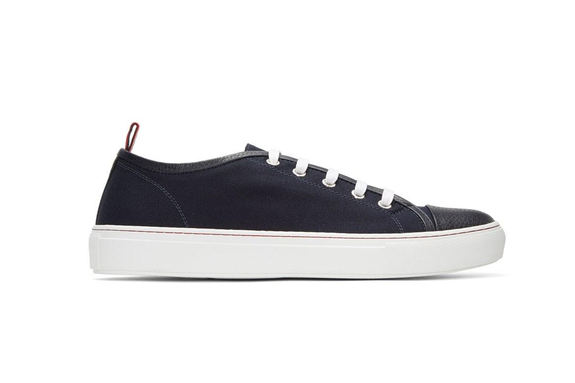 "<p>A boating <em>sneaker</em> is the more modern version of the boat shoe—and will make you look less like a college kid. That said, you might need actual boat money to afford these designer kicks.</p><p><em>$635, buy now at <a rel=""nofollow"" href=""https://www.ssense.com/en-us/men/product/moncler-gamme-bleu/navy-canvas-sneakers/1845983?mbid=synd_yahoostyle"">ssense.com</a></em></p>"