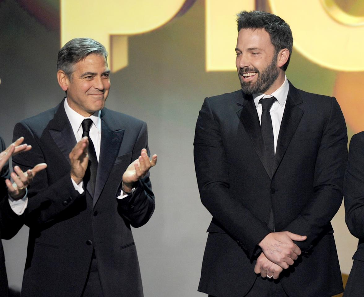 "SANTA MONICA, CA - JANUARY 10:  Producer George Clooney (L) and actor/Producer/Director Ben Affleck accept the Best Picture Award for ""Argo"" onstage at the 18th Annual Critics' Choice Movie Awards held at Barker Hangar on January 10, 2013 in Santa Monica, California.  (Photo by Kevin Winter/Getty Images)"