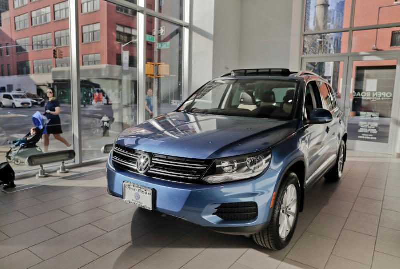 The 2018 Volkswagen Tiguan sits on the showroom floor at the company's New York flagship store during a media preview for the New York International Auto Show, Tuesday, April 11, 2017, in New York. (AP Photo/Julie Jacobson)